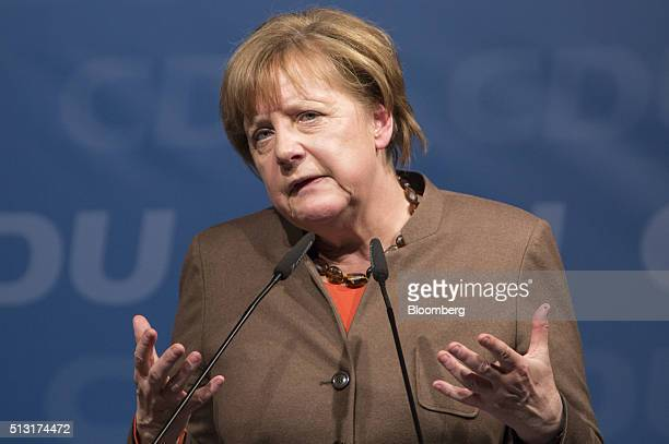 Angela Merkel Germany's chancellor gestures as she speaks during a Christian Democratic Party local election campaign rally in Volkmarsen Germany on...