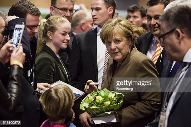 Angela Merkel Germany's chancellor greets attendees before addressing a Christian Democratic Party local election campaign rally in Volkmarsen...