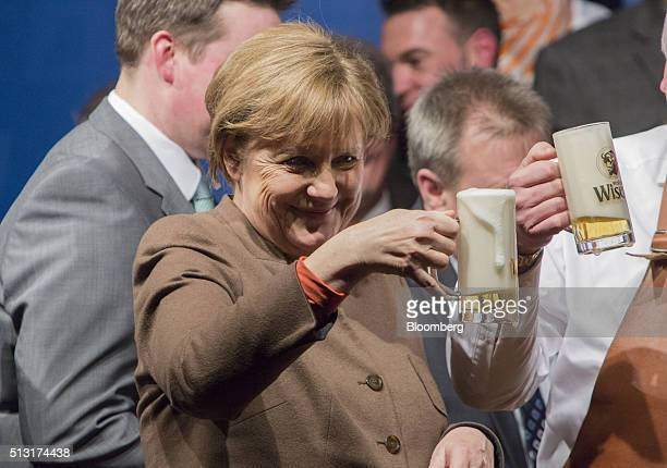 Angela Merkel Germany's chancellor holds a stein glass of beer during a Christian Democratic Party local election campaign rally in Volkmarsen...