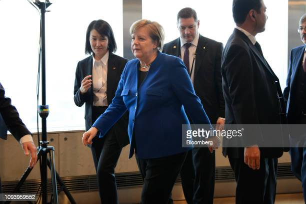 Angela Merkel Germany's chancellor leaves the GermanJapanese Dialogue Forum in Tokyo Japan on Tuesday Feb 5 2019 The German leader brought with her a...