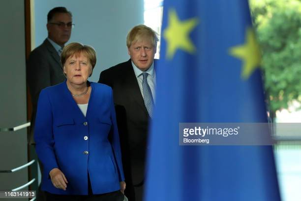 Angela Merkel Germany's chancellor left and Boris Johnson UK prime minister arrive for a news conference at the Chancellery in Berlin Germany on...