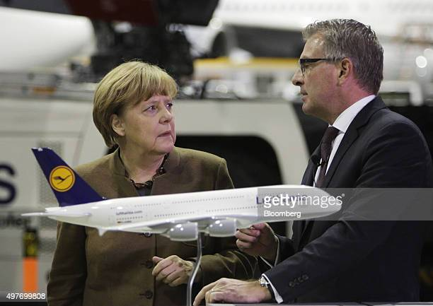 Angela Merkel Germany's chancellor left and Carsten Spohr chief executive officer of Deutsche Lufthansa AG speak during a christening ceremony for a...