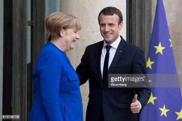 Angela Merkel Germany's chancellor left and Emmanuel Macron France's president react ahead of a FrancoGerman joint cabinet meeting at the Elysee...