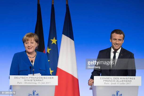 Angela Merkel Germany's chancellor left and Emmanuel Macron France's president react during a news conference following a FrancoGerman joint cabinet...