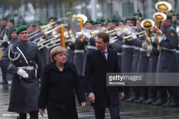 Angela Merkel Germany's chancellor left and Sebastian Kurz Austria's chancellor review an honor guard as he arrives at the Chancellery in Berlin...