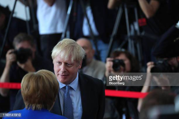 Angela Merkel Germany's chancellor left greets Boris Johnson UK prime minister at the Chancellery in Berlin Germany on Wednesday Aug 21 2019 At their...