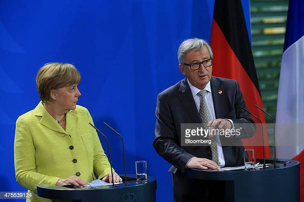 Angela Merkel Germany's chancellor left listens as JeanClaude Juncker European commission president speaks during a news conference in Berlin Germany...