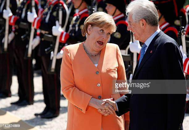 Angela Merkel Germany's chancellor left reacts as she is greeted by Mario Monti Italy's prime minister ahead of their meeting at Villa Madama in Rome...