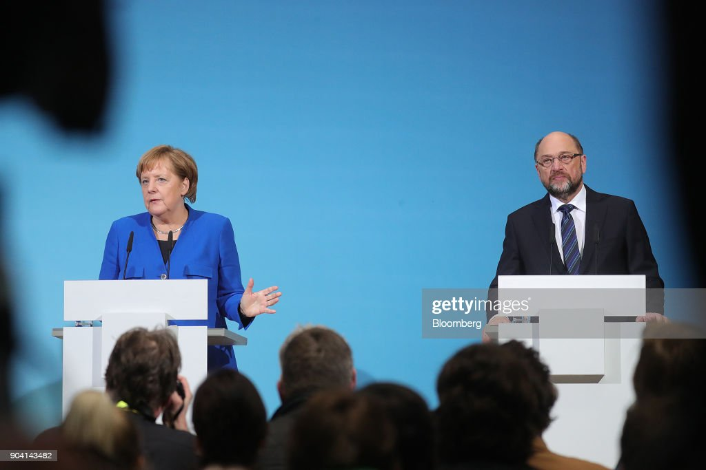 Angela Merkel, Germany's chancellor, left, speaks as Martin Schulz, leader of the Social Democrat Party (SPD), looks on during a news conference following overnight coalition negotiations, at the SPD headquarters in Berlin, Germany, on Friday, Jan. 12, 2018. After a marathon of more than 24 hours of talks to end Germanys political gridlock, leaders of Merkels Christian Democratic Union, her Bavarian sister party and the Social Democrats hammered out a 28-page agreement. Photographer: Krisztian Bocsi/Bloomberg via Getty Images