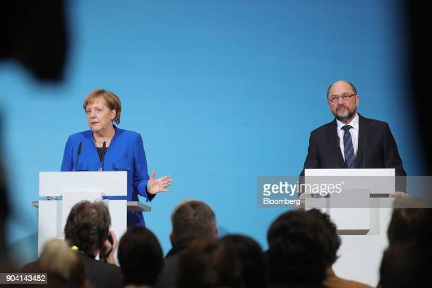 Angela Merkel Germany's chancellor left speaks as Martin Schulz leader of the Social Democrat Party looks on during a news conference following...