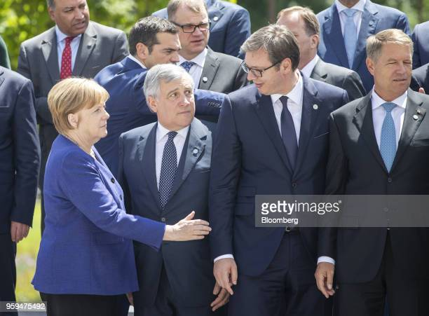 Angela Merkel Germany's chancellor left speaks to Aleksandar Vucic Serbia's president second right as Antonio Tajani European Parliament president...