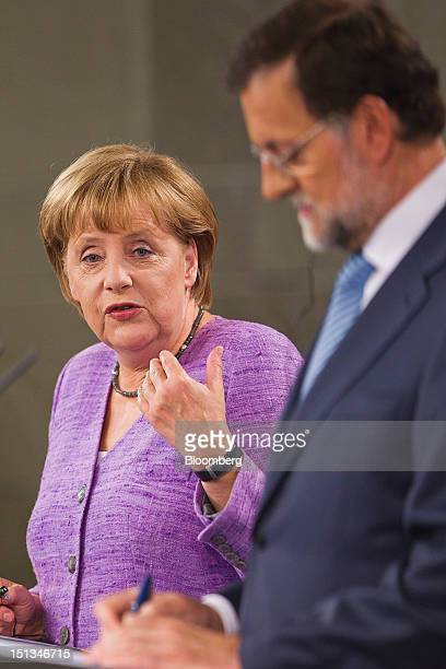 Angela Merkel Germany's chancellor left speaks while Mariano Rajoy Spain's prime minister listens during a joint news conference at the Monclau...