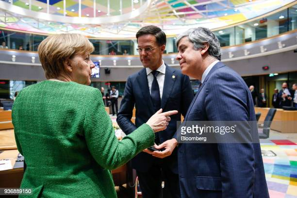 Angela Merkel Germany's chancellor left speaks with Mario Centeno Portugal's finance minister and head of the group of euroarea finance ministers...