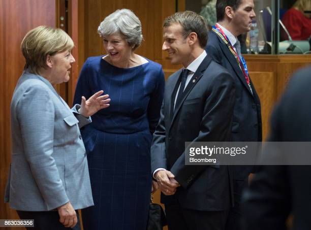 Angela Merkel Germany's chancellor left speaks with Theresa May UK prime minister center and Emmanuel Macron France's president ahead of roundtable...
