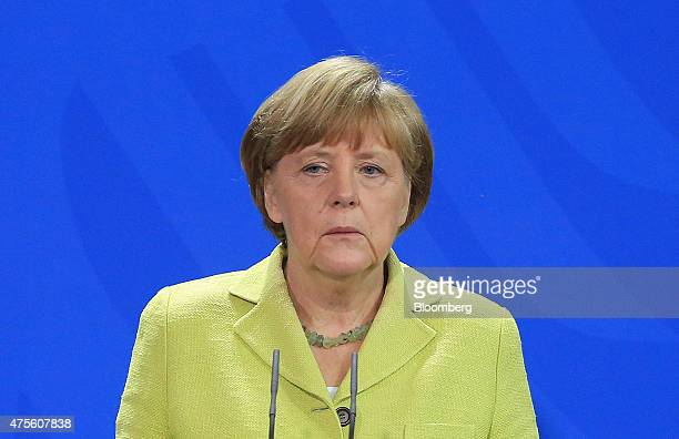 Angela Merkel Germany's chancellor listens during a news conference in Berlin Germany on Monday June 1 2015 With technical talks yielding no...