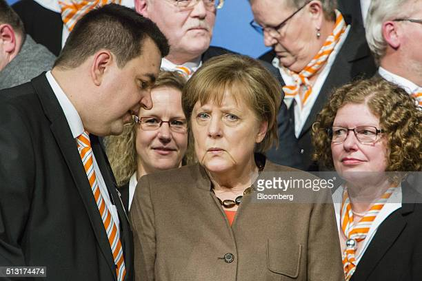 Angela Merkel Germany's chancellor listens to a party member during a Christian Democratic Party local election campaign rally in Volkmarsen Germany...