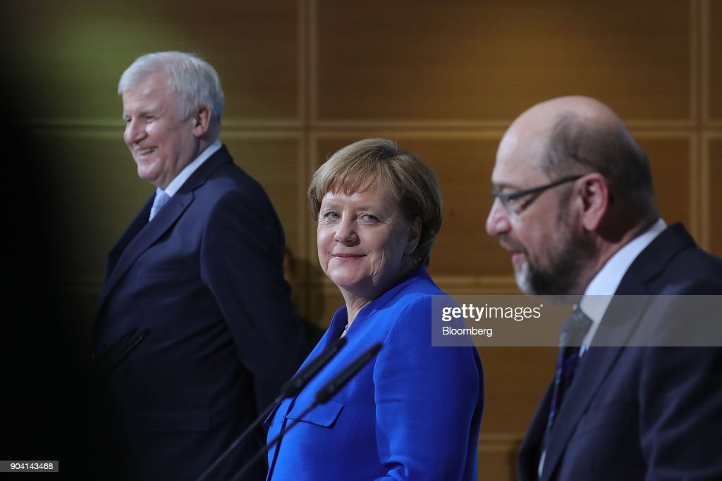 Angela Merkel, Germany's chancellor, looks towards Martin Schulz, leader of the Social Democrat Party (SPD), during a news conference following overnight coalition negotiations, at the SPD headquarters in Berlin, Germany, on Friday, Jan. 12, 2018. After a marathon of more than 24 hours of talks to end Germanys political gridlock, leaders of Merkels Christian Democratic Union, her Bavarian sister party and the Social Democrats hammered out a 28-page agreement. Photographer: Krisztian Bocsi/Bloomberg via Getty Images