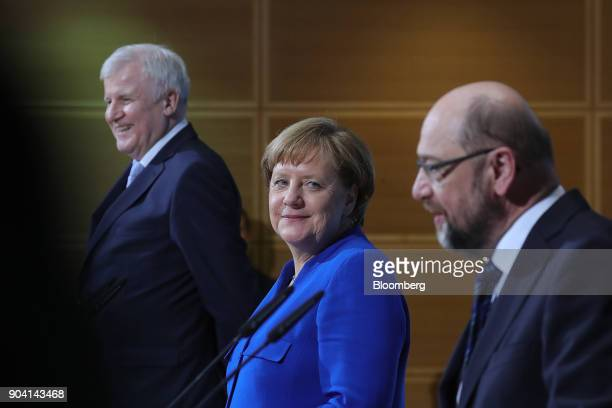 Angela Merkel Germany's chancellor looks towards Martin Schulz leader of the Social Democrat Party during a news conference following overnight...