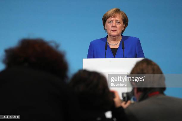 Angela Merkel Germany's chancellor pauses during a news conference following overnight coalition negotiations at the Social Democratic Party...