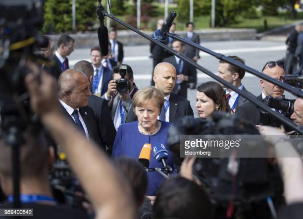 Angela Merkel Germany's chancellor pauses while making a statement to journalists as she arrives for a summit of European Union leaders in Sofia...