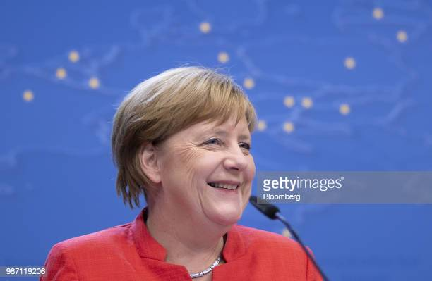 Angela Merkel Germany's chancellor reacts during a news conference at the European Union leaders summit in Brussels Belgium on Friday June 29 2018 EU...
