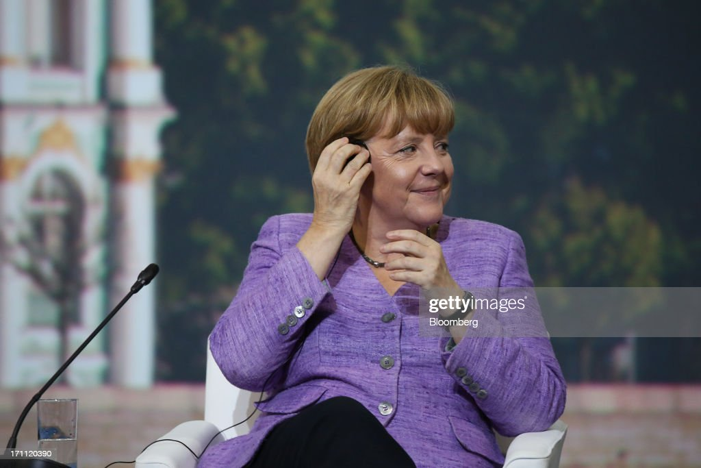 Angela Merkel, Germany's chancellor, reacts during a session with Vladimir Putin, Russia's president, on day two of the St. Petersburg International Economic Forum 2013 (SPIEF) in St. Petersburg, Russia, on Friday, June 21, 2013. President Vladimir Putin is battling investor skepticism to woo foreign executives descending on his hometown today as Russia's economy faces a risk of recession and a crackdown on critics scares off intellectuals. Photographer: Andrey Rudakov/Bloomberg via Getty Images