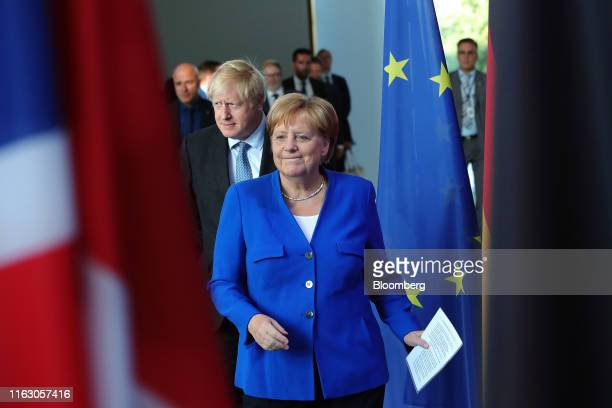 Angela Merkel Germany's chancellor right and Boris Johnson UK prime minister arrive for a news conference at the Chancellery in Berlin Germany on...
