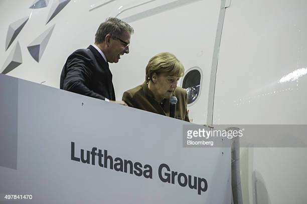 Angela Merkel Germany's chancellor right and Carsten Spohr chief executive officer of Deutsche Lufthansa AG inspect the fuselage of an Airbus A380...