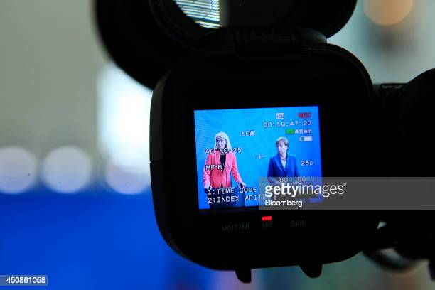 Angela Merkel Germany's chancellor right and Helle ThorningSchmidt Denmark's prime minister are seen on a camera viewfinder during a news conference...