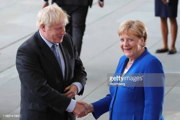 Angela Merkel Germany's chancellor right greets Boris Johnson UK prime minister at the Chancellery in Berlin Germany on Wednesday Aug 21 2019 At...