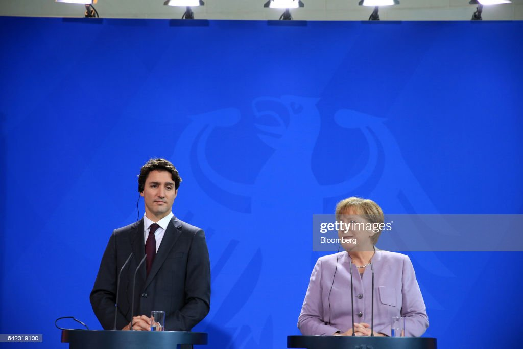 Angela Merkel, Germany's chancellor, right, speaks as Justin Trudeau, Canada's prime minister, looks on during a news conference at the Chancellery in Berlin, Germany, on Friday, Feb. 17, 2017. Military spending is not the only measure of a countrys contribution to the North Atlantic Treaty Organization, Trudeau said. Photographer: Krisztian Bocsi/Bloomberg via Getty Images