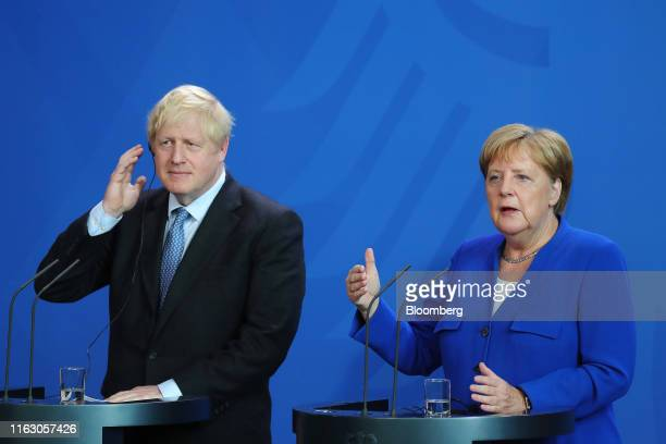 Angela Merkel Germany's chancellor right speaks beside Boris Johnson UK prime minister during a news conference at the Chancellery in Berlin Germany...