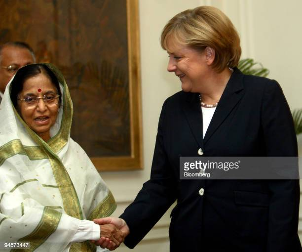 Angela Merkel Germany's chancellor shakes hands with Pratibha Patil India's president at the Presidential Palace in New Delhi India on Tuesday Oct 30...