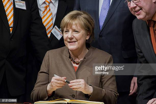 Angela Merkel Germany's chancellor smiles for a photograph before addressing a Christian Democratic Party local election campaign rally in Volkmarsen...