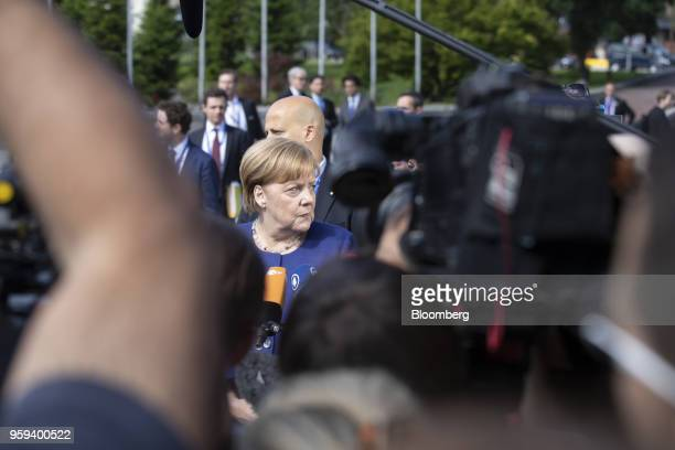 Angela Merkel Germany's chancellor speaks to journalists as she arrives for a summit of European Union leaders in Sofia Bulgaria on Thursday May 17...