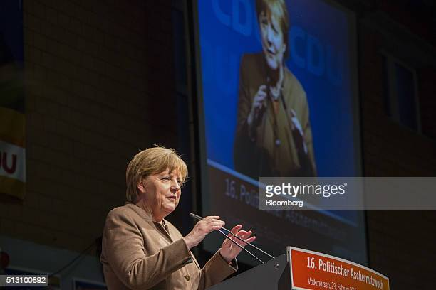 Angela Merkel Germany's chancellor speaks while addressing a Christian Democratic Party local election campaign rally in Volkmarsen Germany on Monday...
