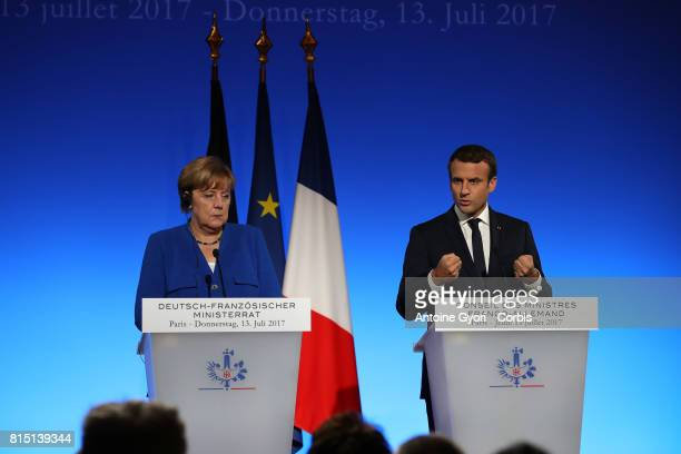 Angela Merkel Germany's chancellor stands beside Emmanuel Macron France's president during a news conference following a FrancoGerman joint cabinet...