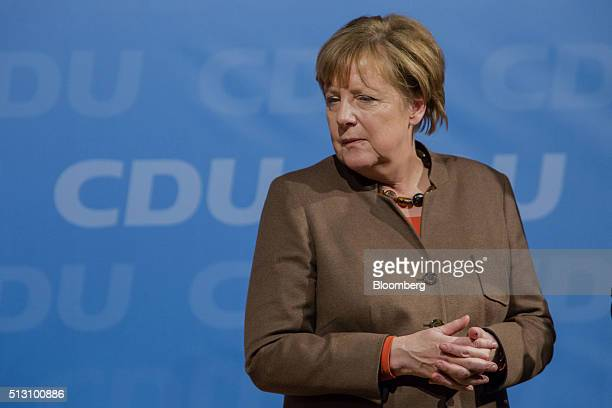 Angela Merkel Germany's chancellor stands on stage before addressing a Christian Democratic Party local election campaign rally in Volkmarsen Germany...