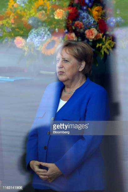 Angela Merkel Germany's chancellor waits for the arrival of Boris Johnson UK prime minister at the Chancellery in Berlin Germany on Wednesday Aug 21...