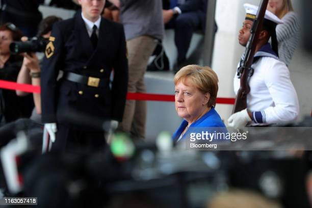 Angela Merkel Germany's chancellor waits to greet Boris Johnson UK prime minister before reviewing an honor guard at the Chancellery in Berlin...