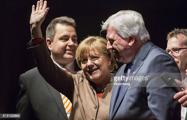Angela Merkel Germany's chancellor waves to attendees before addressing a Christian Democratic Party local election campaign rally in Volkmarsen...