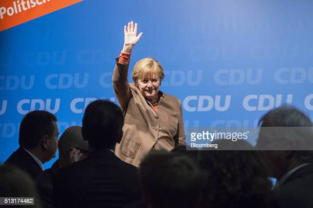 Angela Merkel Germany's chancellor waves to supporters during a Christian Democratic Party local election campaign rally in Volkmarsen Germany on...