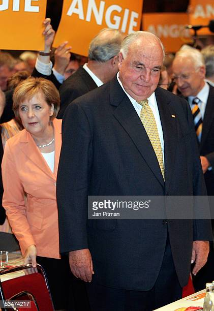 Angela Merkel head of the Christian Democratic Union stands behind former chancellor Helmut Kohl during the preelection congress of the CDU August 28...