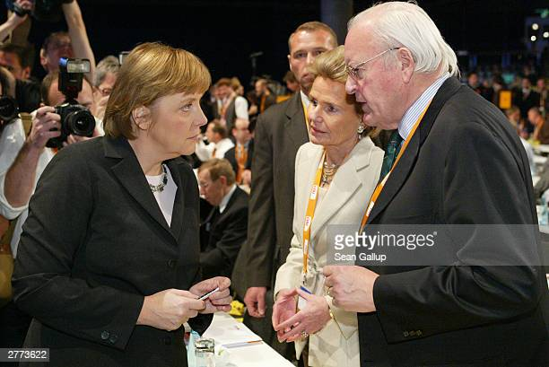 Angela Merkel head of the Christian Democratic Union the leading opposition party in Germany speaks with former German president Roman Herzog and...