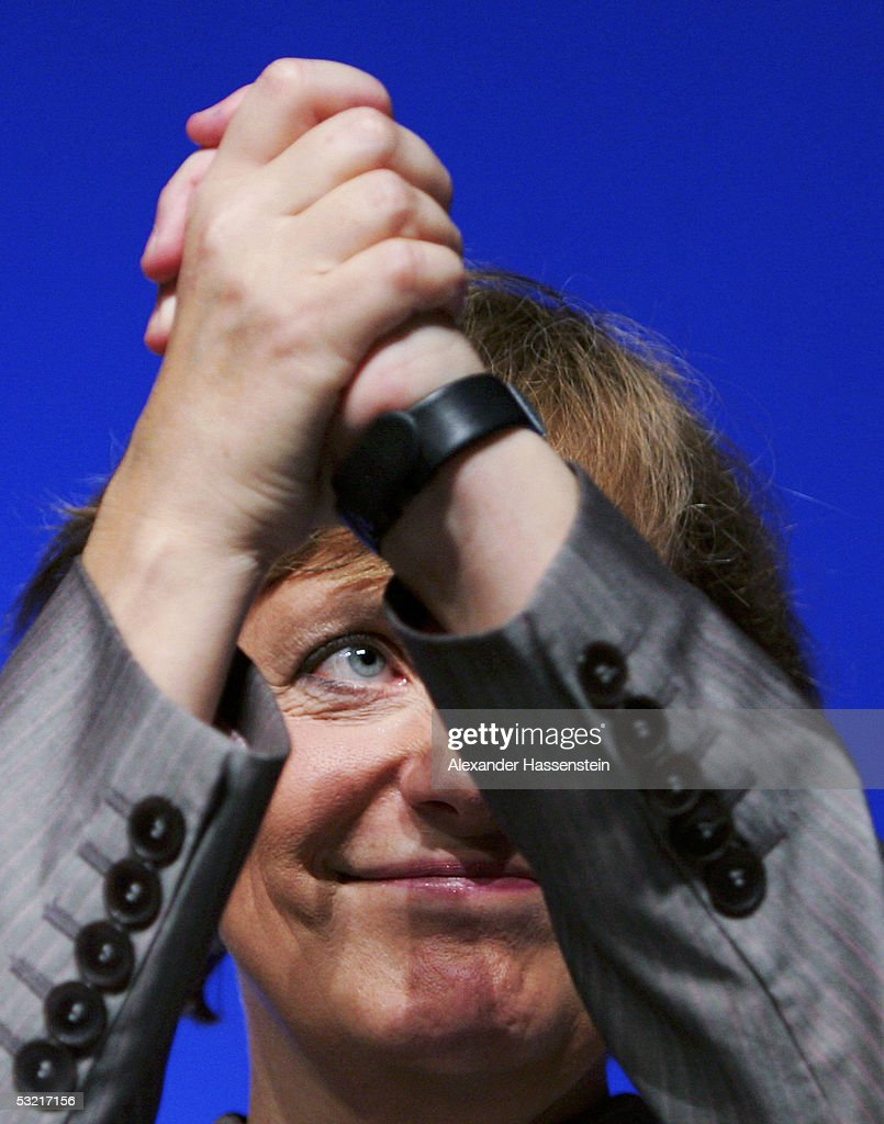 Angela Merkel (L) , head of the opposition Christian Democrats, the CDU, raises clasps her hands during the Lower Saxony Christian Democratic Party's annual general meeting on July 9, 2005 in Emden, Germany. Merkel is concidered the Christian Democrats top candiadate for the German general elections in September.