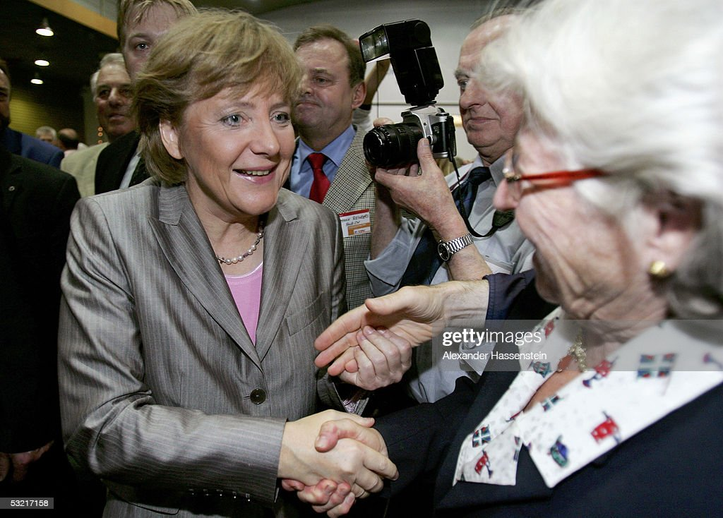 Angela Merkel (L) , head of the opposition Christian Democrats, the CDU, talks with delegates at the Lower Saxony Christian Democratic Party's annual general meeting on July 9, 2005 in Emden, Germany. Merkel is concidered the Christian Democrats top candiadate for the German general elections in September.