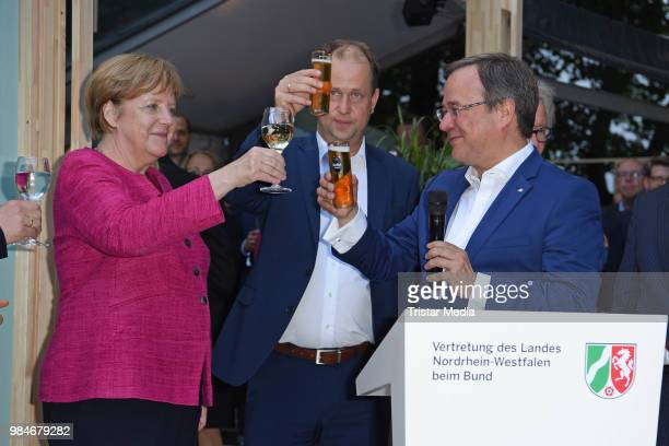 Angela Merkel, Joachim Stamp and Armin Laschet attend the Landesvertretung NRW summer party on June 26, 2018 in Berlin, Germany.