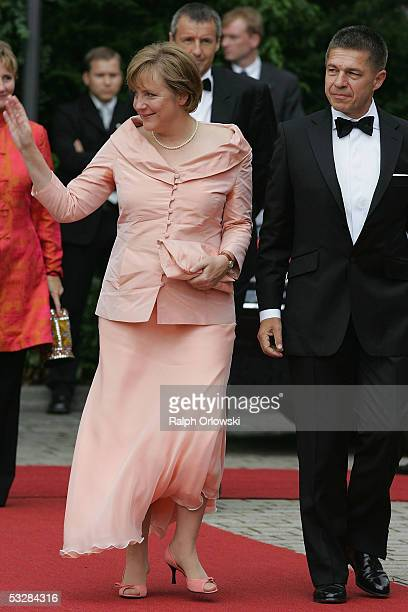 Angela Merkel leader of Germany's Christian Democratic Union and her husband Joachim Sauer arrive for the opening performance of Richard Wagner's...