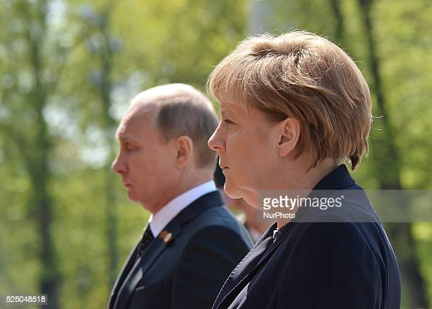 Angela Merkel, the Chancellor of Germany and Vladimir Putin, the President of Russia, during the laying wreath at the Tomb of the Unknown Soldier, a...