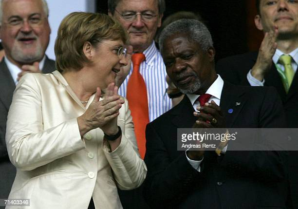 Angela Merkel , the German chancellor speaks with Kofi Annan , the UN Secretary General during the FIFA World Cup Germany 2006 Final match between...